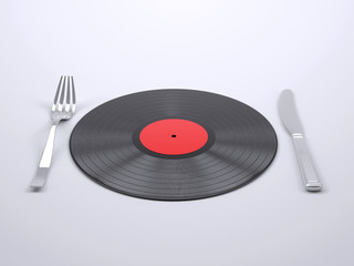 A dish with vinyl record with fork and knife