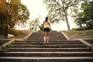 Woman running on steps in park