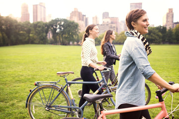 Young women with bicycles in Central Park