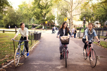 Young women riding bicycles in Central Park