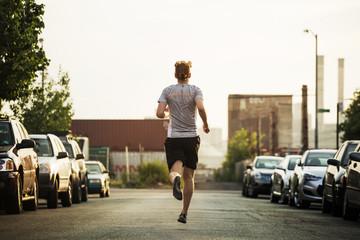 Man jogging in street