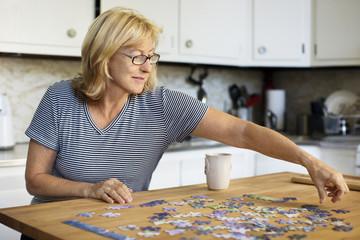 Senior woman assembling jigsaw puzzle