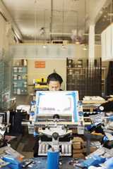 Man working at printing press