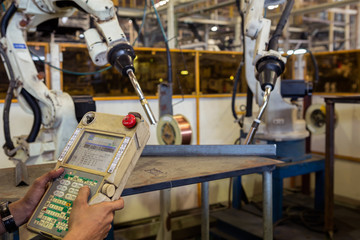 Operator is teaching robot for new program