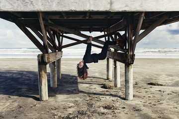 Woman climbing pier