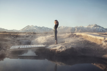 Woman relaxing by hot spring