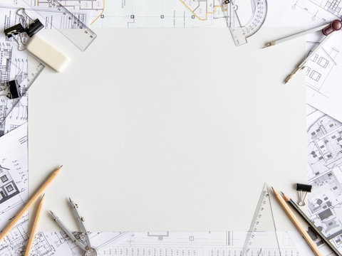 Architectural plans, pencil and ruler on the table. Place for your text