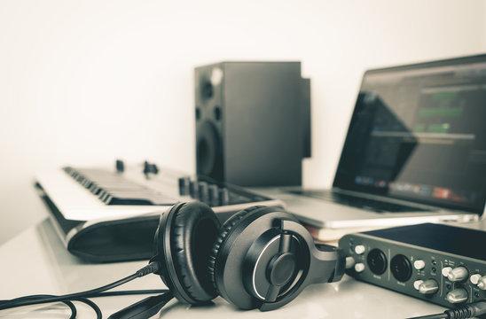 Music headphone lying on Music studio working desktop