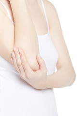 Young woman torso with hand holding elbow in pain isolated on white, clipping path