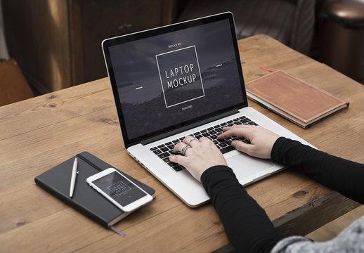 User with Laptop on Desk Mockup 1