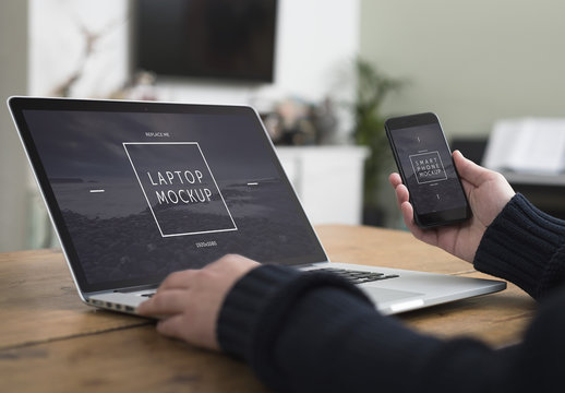 User with Smartphone and Laptop on Desk Mockup 3