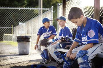 Baseball players sitting on bench