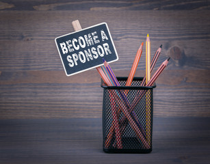 Become a Sponsor. A small blackboard chalk and colored pencil on wood background.