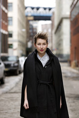 Portrait of woman wearing coat outdoors