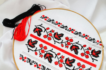 Slavic red and black embroidery by cross-stitch.
