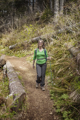 Mature woman hiking in forest