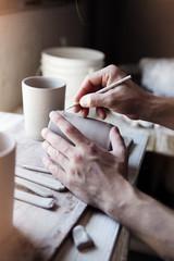 Potter carving mug, close-up