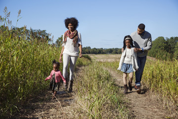 Family walking on countryside road