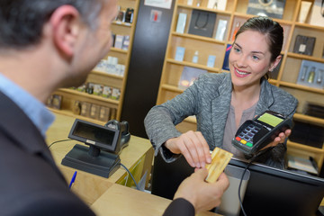 woman taking payment from man