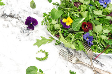 Green salad herbs edible flowers Healthy food Detox