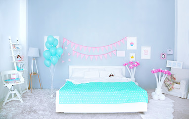 Beautiful interior of child's room decorated for birthday celebration