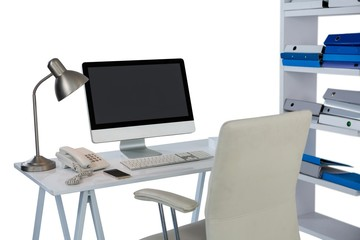 Computer with telephone and mobile phone at desk
