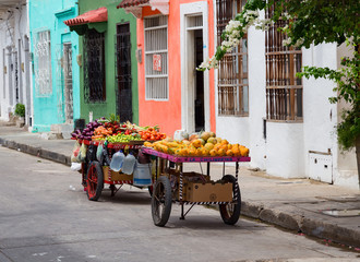 A fruit cart sits on the side of the road in the Getsemani neighborhood of Cartagena, Colombia.