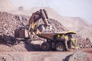 Loading of copper ore on very big dump-body truck