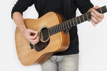 Caucasian Man Playing Guitar Closeup