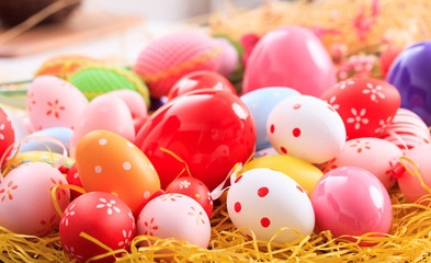 Easter eggs on straw background