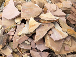 Arizona rosa flagstone pieces stacked on top of each other
