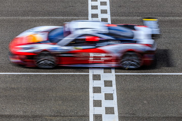 Motion blur, Race car racing on speed track