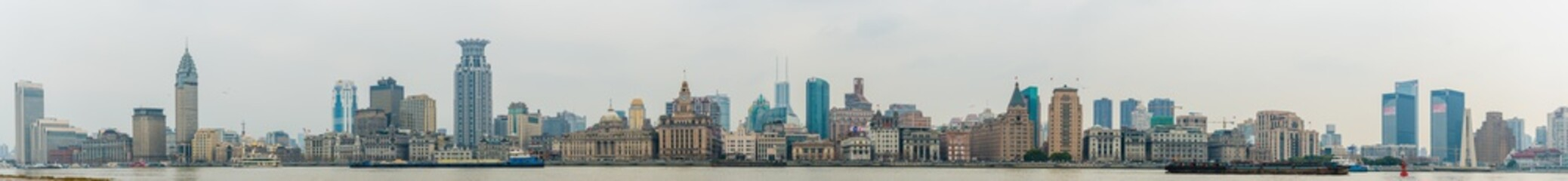 panoramic view of River Boats on the Huangpu River and as Background the Skyline of the Northern Part of Puxi