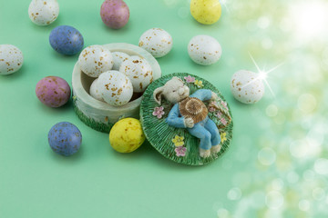 Easter egg background - bunny sleeping in meadow with speckled eggs - concepts