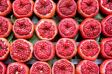 Background pattern of red sliced pomegranates