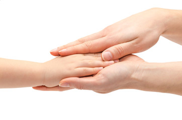 hand of young girl holding kids hand.