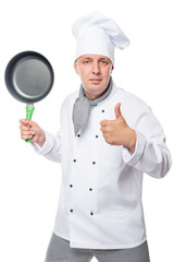 satisfied chef showing thumbs up and holding a frying pan on a white background
