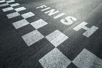 Sunny finish line pattern racing background on the asphalt floor. Wall mural