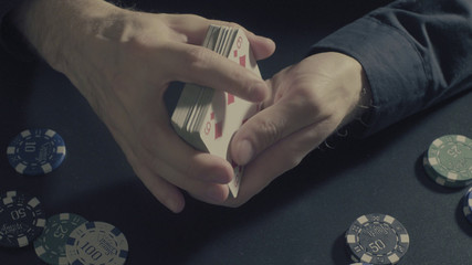 Man's hands shuffing cards. Pocker game