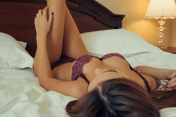 beautiful and sexy woman lying in bed