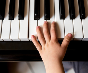 Child's hands playing piano