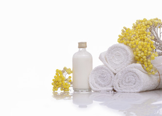 Products for spa towel, spa oil, branch yellow flower