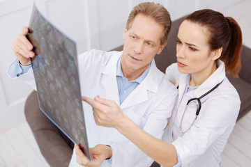 Prominent doctor and his intern discussing the diagnosis