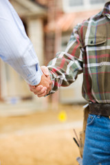 Construction: Agent and Contractor Shake Hands