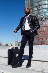 Confident young gentleman with suitcase