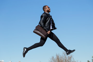 Young businessman in moment of jumping