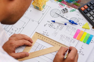 Architect workplace - architectural project, blueprints, ruler. Construction concept. Engineering tools.
