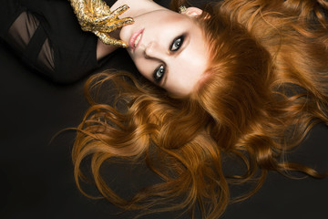 Foto op Canvas Vlam Red-haired woman with smokey eyes