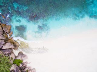 Seychelles Island white tropical paradise beach, turquoise sea and granite rocks aerial landscape. La Digue Grand Anse beach seascape.