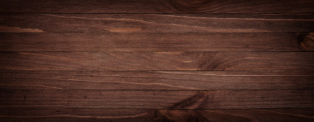 Dark brown scratched wooden cutting board. Wood texture background